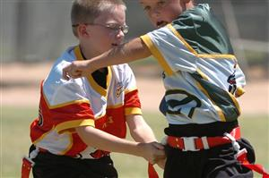 Two flag football players running